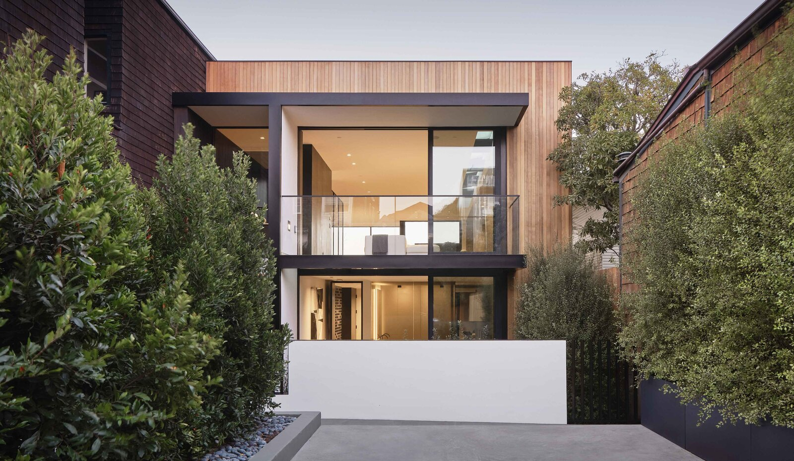 Another view of the front facade shows the parking area alongside steel-plated planter boxes that help create additional privacy along the side of the home.  Photo 19 of 19 in This Radiant San Francisco Residence Hits the Market at $6.8M