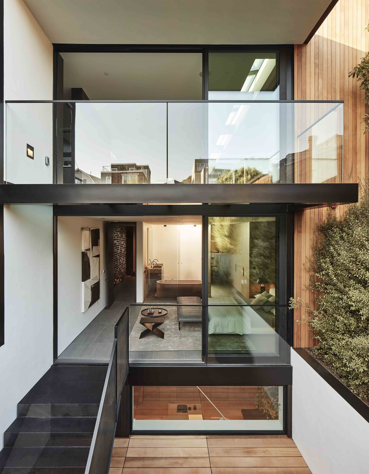 A front view of the home shows the principal bedroom opening to the sunken patio.  Photo 18 of 19 in This Radiant San Francisco Residence Hits the Market at $6.8M