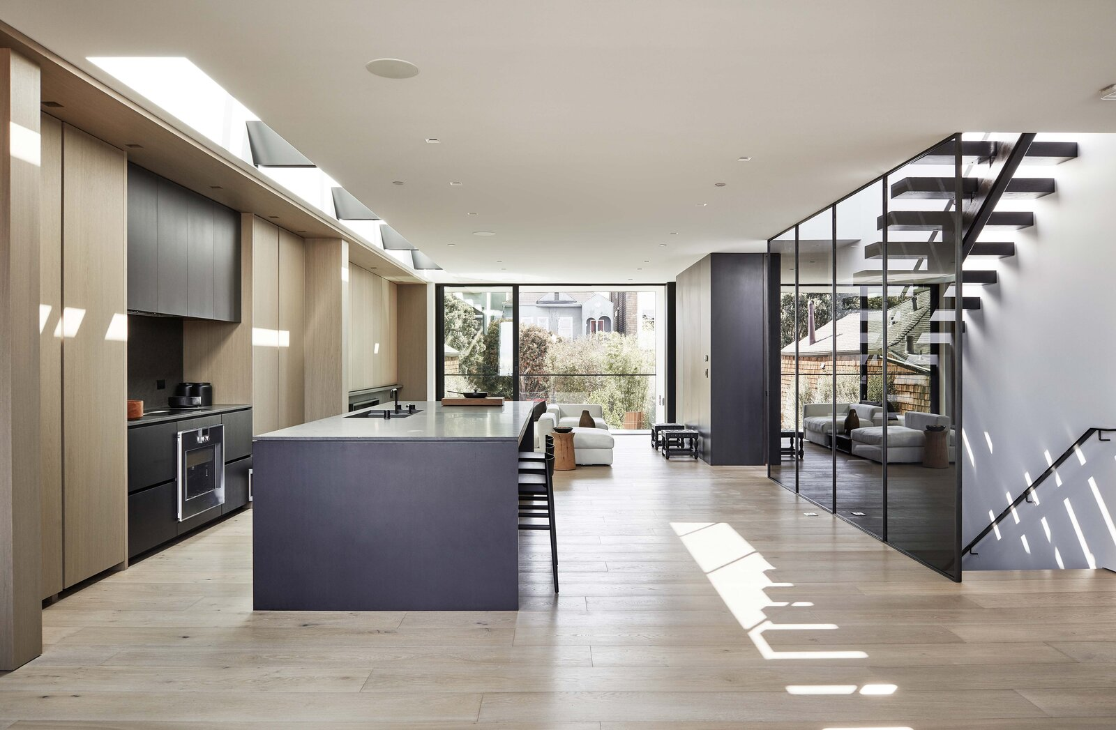 A large island grounds the kitchen in the middle of the space.