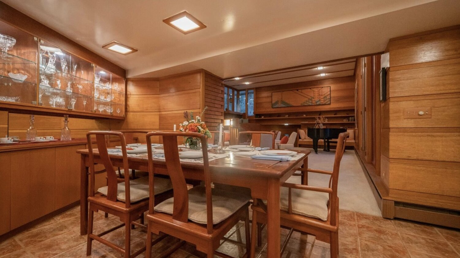 The living room also flows into a formal dining area, which features additional built-in cabinetry along one wall.  Photo 6 of 11 in Frank Lloyd Wright's Dune House Hits the Market for $1.2M
