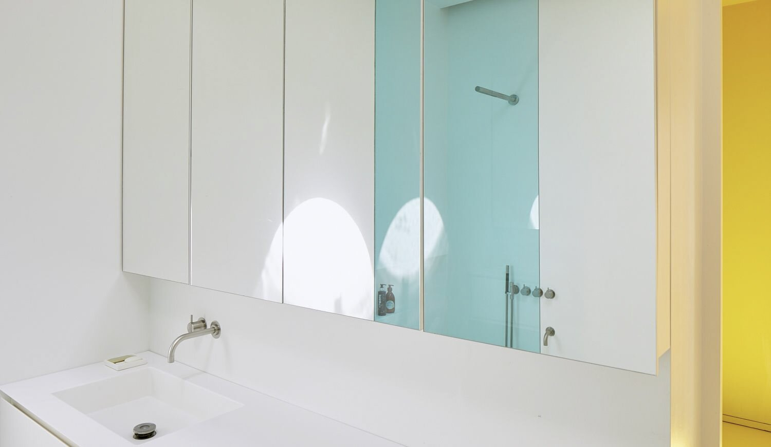 A look at the home's only bathroom.  Photo 10 of 17 in For €795K, You Can Buy This Boxy Belgian Home With a Surprisingly Colorful Interior