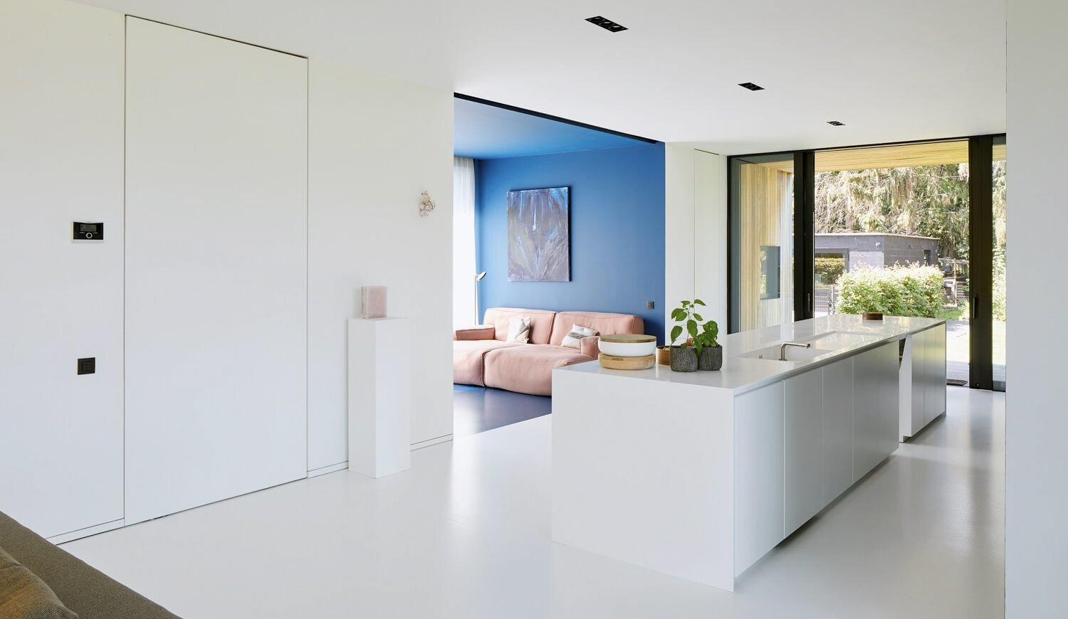 Doors to each of the home's four bedrooms are integrated into the wall.  Photo 6 of 17 in For €795K, You Can Buy This Boxy Belgian Home With a Surprisingly Colorful Interior