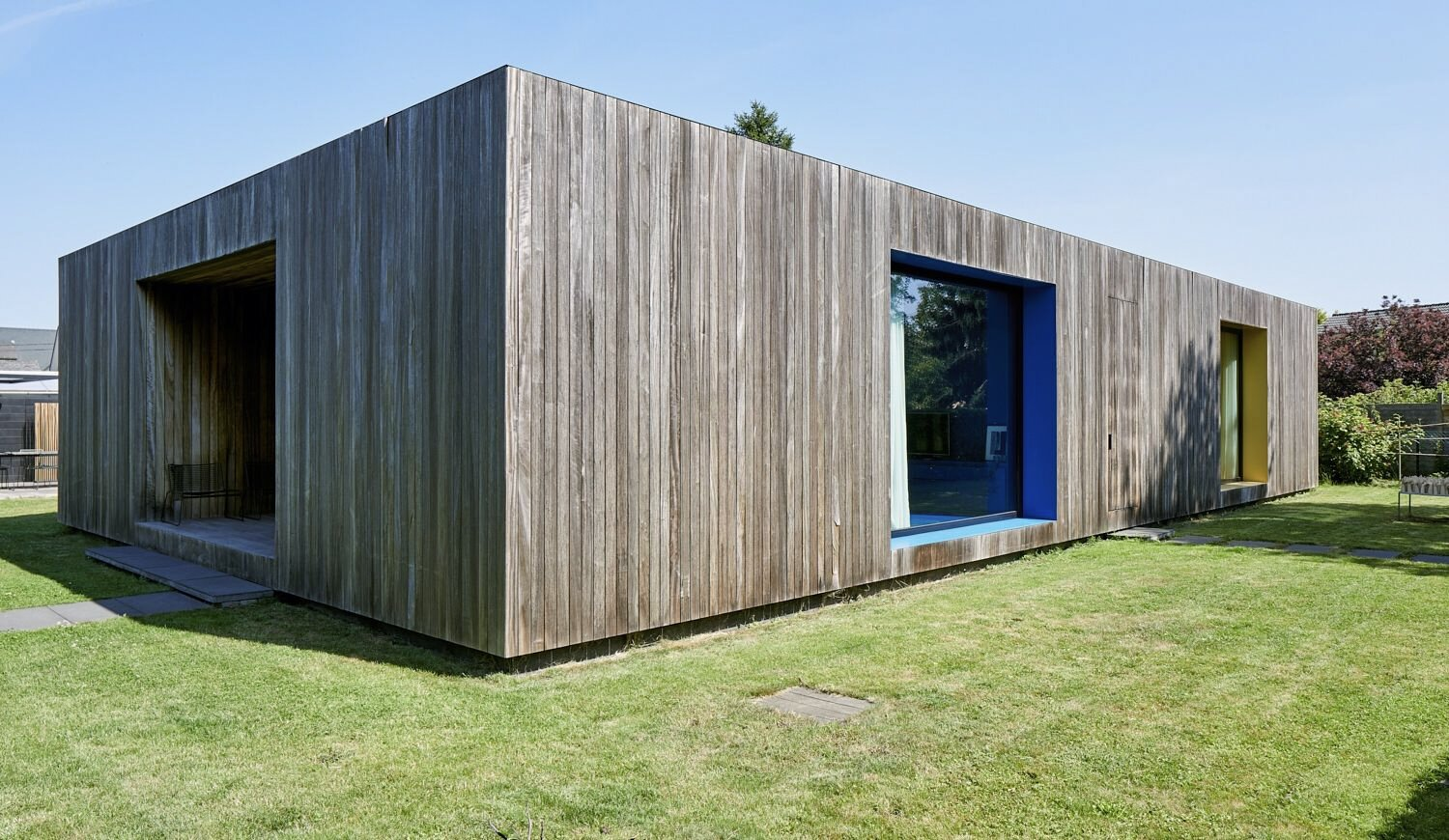 """This recently listed home near Brussels features colorful interior rooms that punctuate the facade. Each of the """"color boxes,  Photo 1 of 17 in For €795K, You Can Buy This Boxy Belgian Home With a Surprisingly Colorful Interior"""