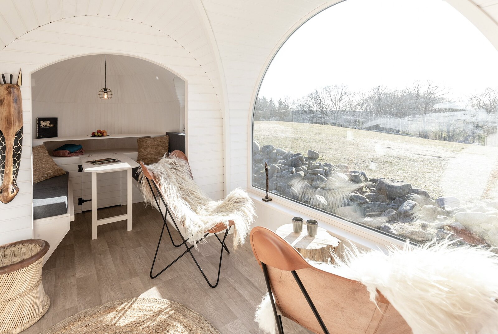 Dining Room On the opposite side, a dining alcove doubles as an additional sleeping area if needed.  Photo 5 of 9 in Spend the Night With Lions, Tigers, and Bears in These Prefab Glamping Pods