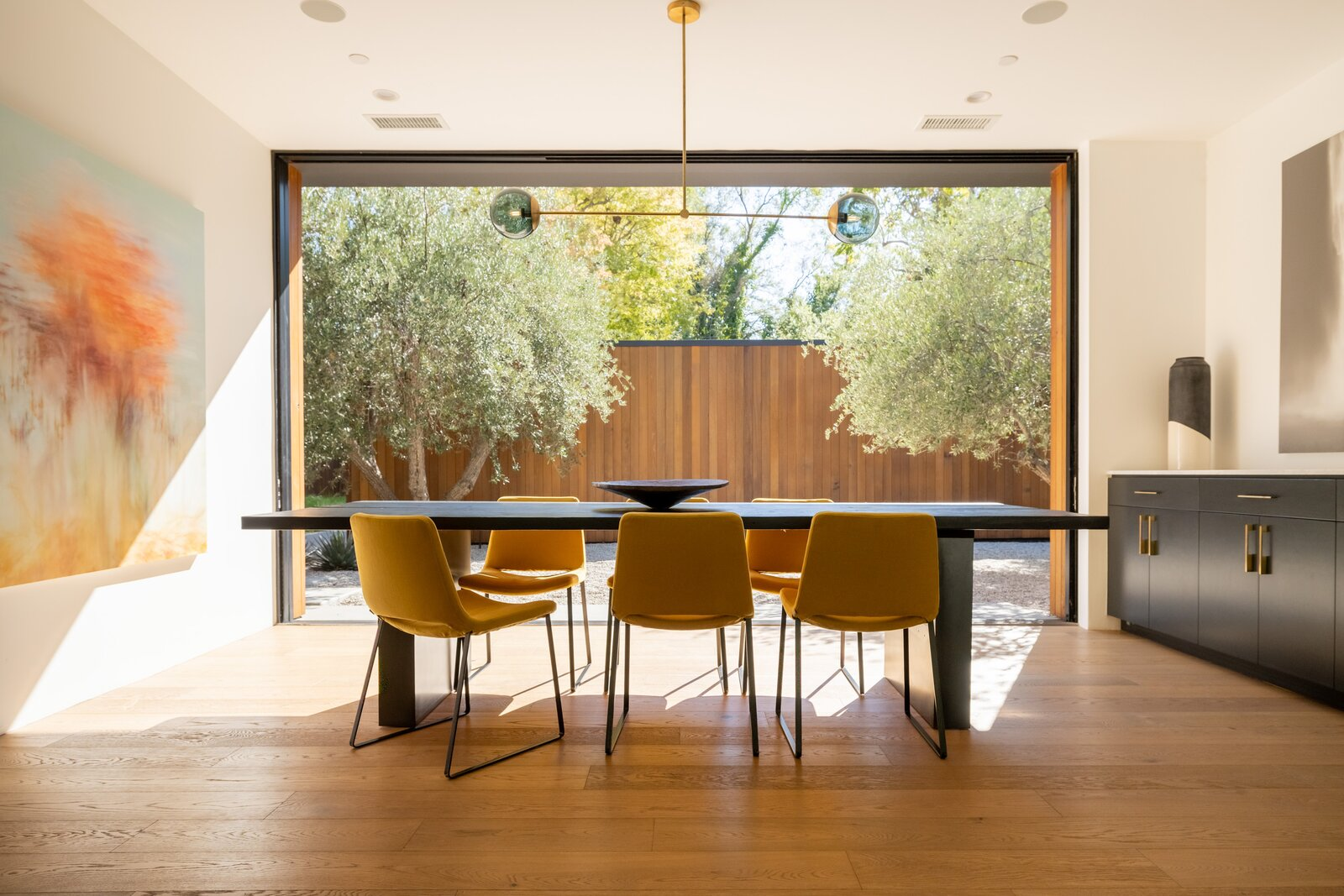Dining room of Laurel Hills Residence by Assembledge+