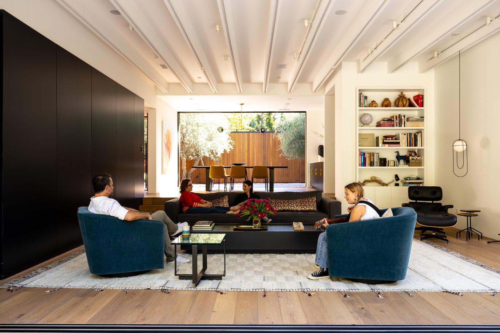 Living room of Laurel Hills Residence by Assembledge+