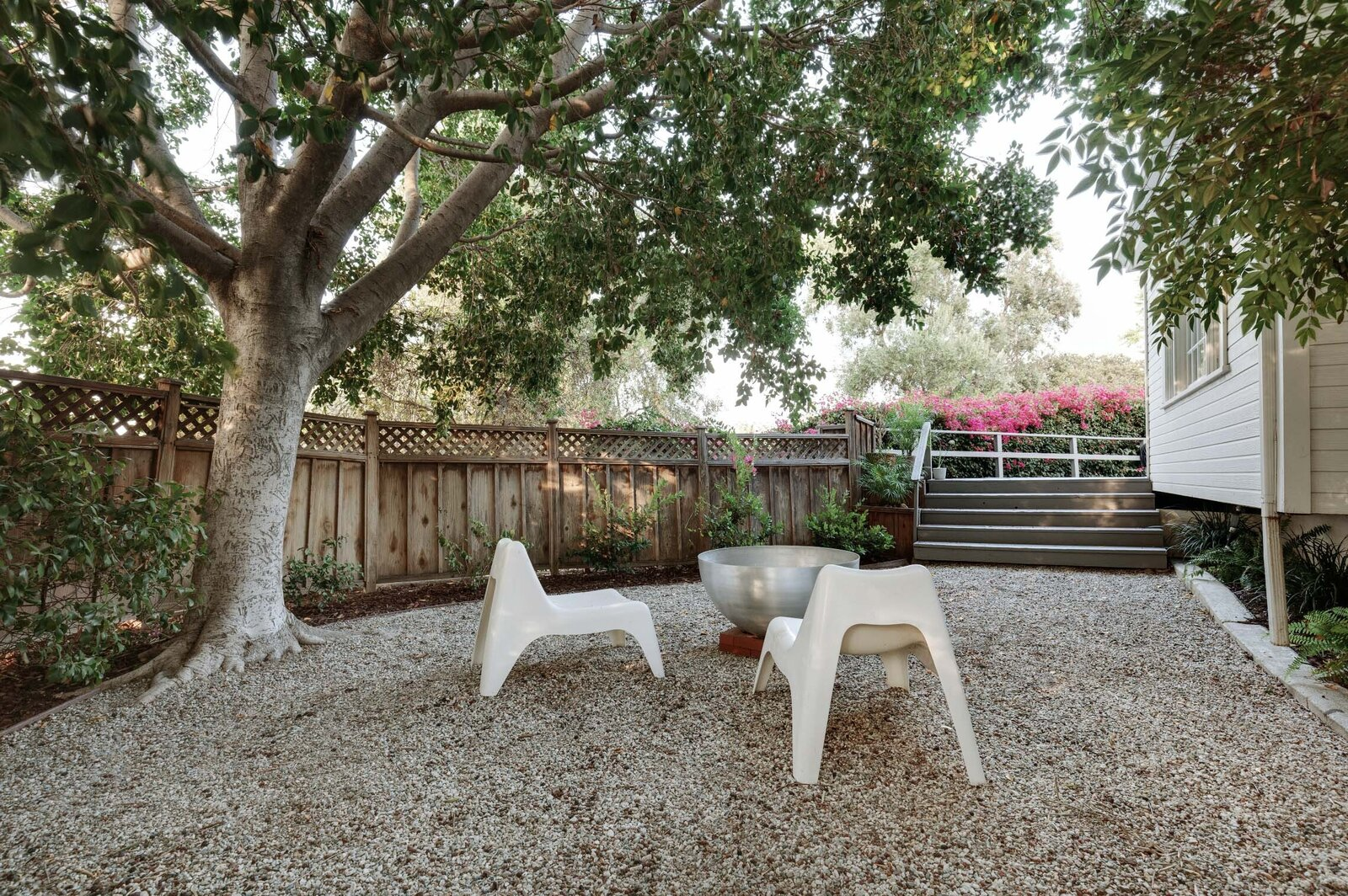 A shaded seating area is located along the rear corner of the property.  Photo 13 of 16 in Listed at $950K, This Clean-Lined Cottage in Los Angeles Is a Fresh Take on City Living