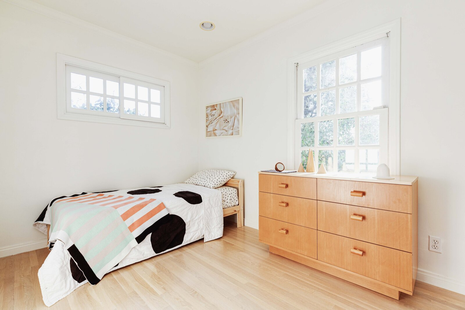 A look at the second bedroom.  Photo 11 of 16 in Listed at $950K, This Clean-Lined Cottage in Los Angeles Is a Fresh Take on City Living