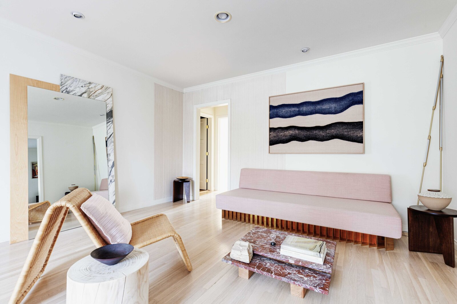 A spacious living area anchors the center of the home; a hallway leads to the bedrooms and bathroom.  Photo 3 of 16 in Listed at $950K, This Clean-Lined Cottage in Los Angeles Is a Fresh Take on City Living