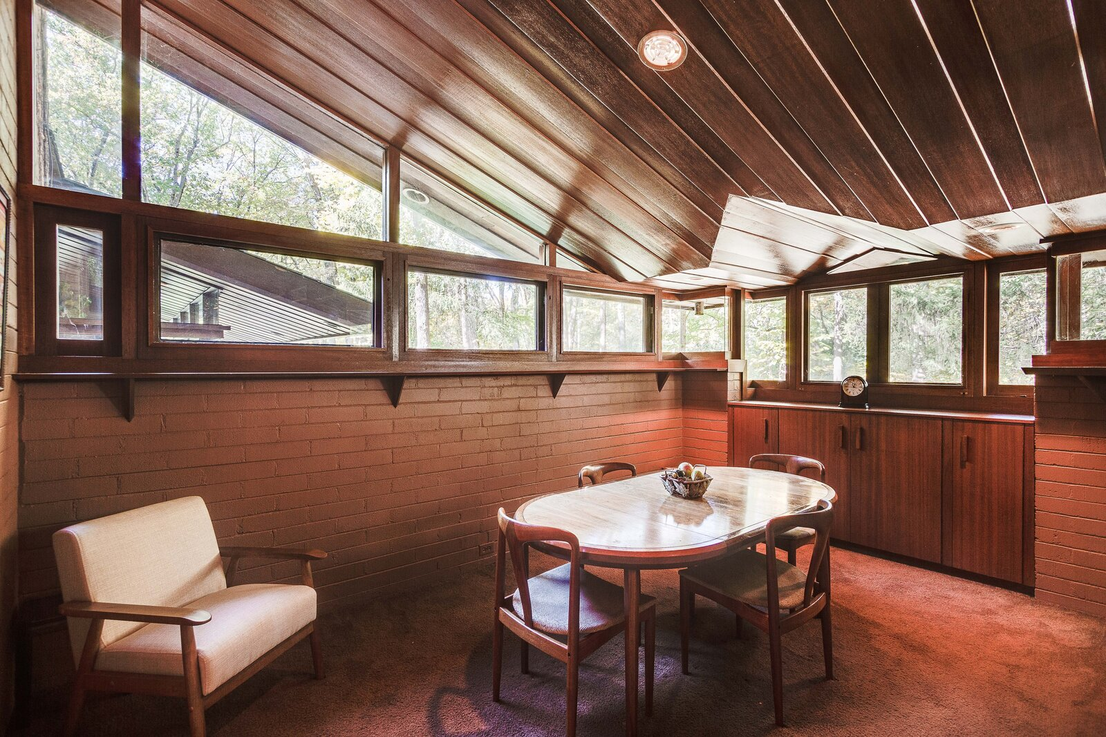 A dining area is located beside of the kitchen.  Photo 9 of 17 in For the First Time Ever, This Winsome Illinois Home by Frank Lloyd Wright Is on the Market