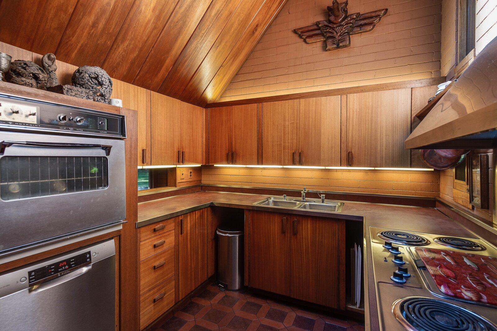A look at the U-shaped kitchen.  Photo 8 of 17 in For the First Time Ever, This Winsome Illinois Home by Frank Lloyd Wright Is on the Market