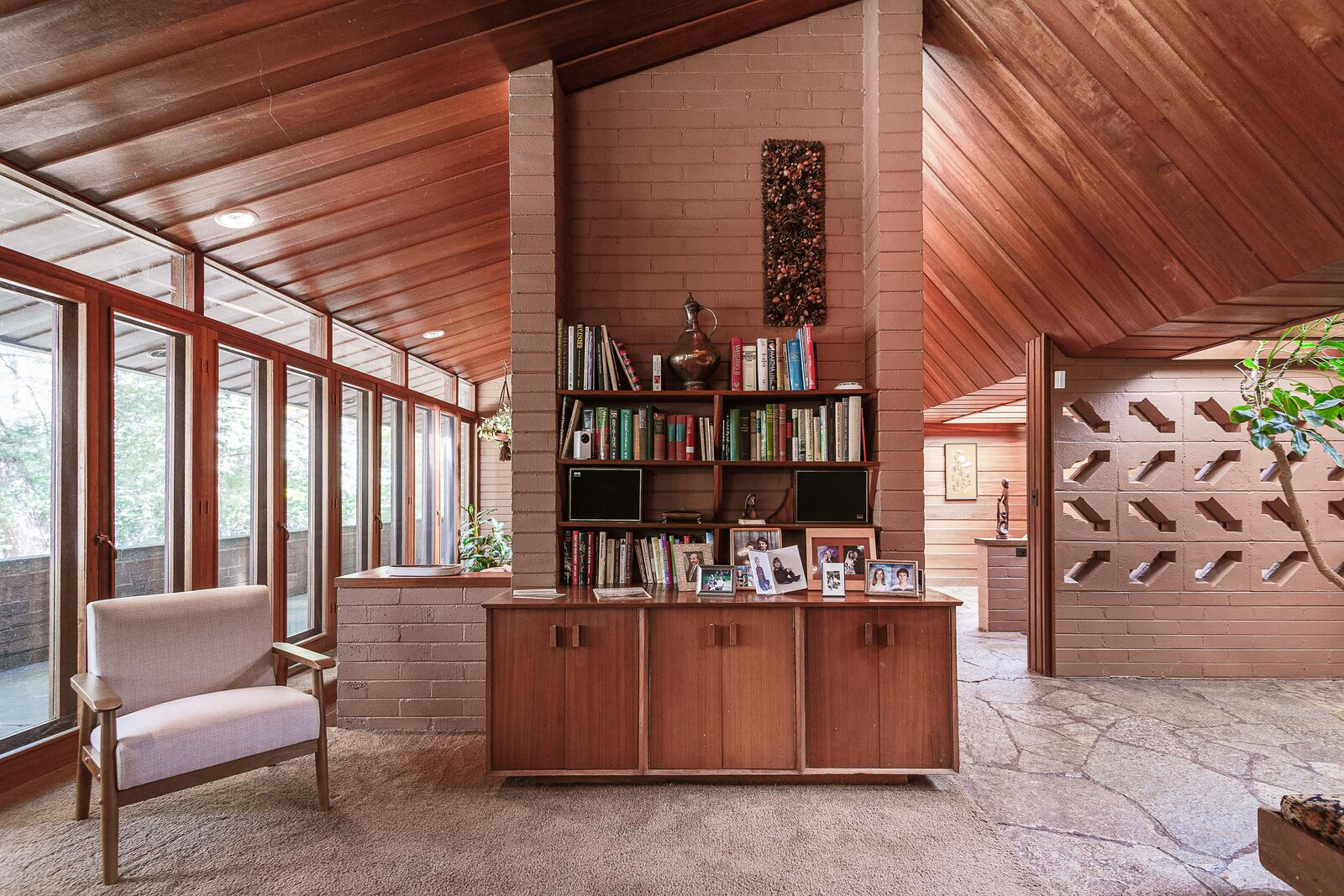 A central area of built-in cabinetry and shelving  Photo 6 of 17 in For the First Time Ever, This Winsome Illinois Home by Frank Lloyd Wright Is on the Market