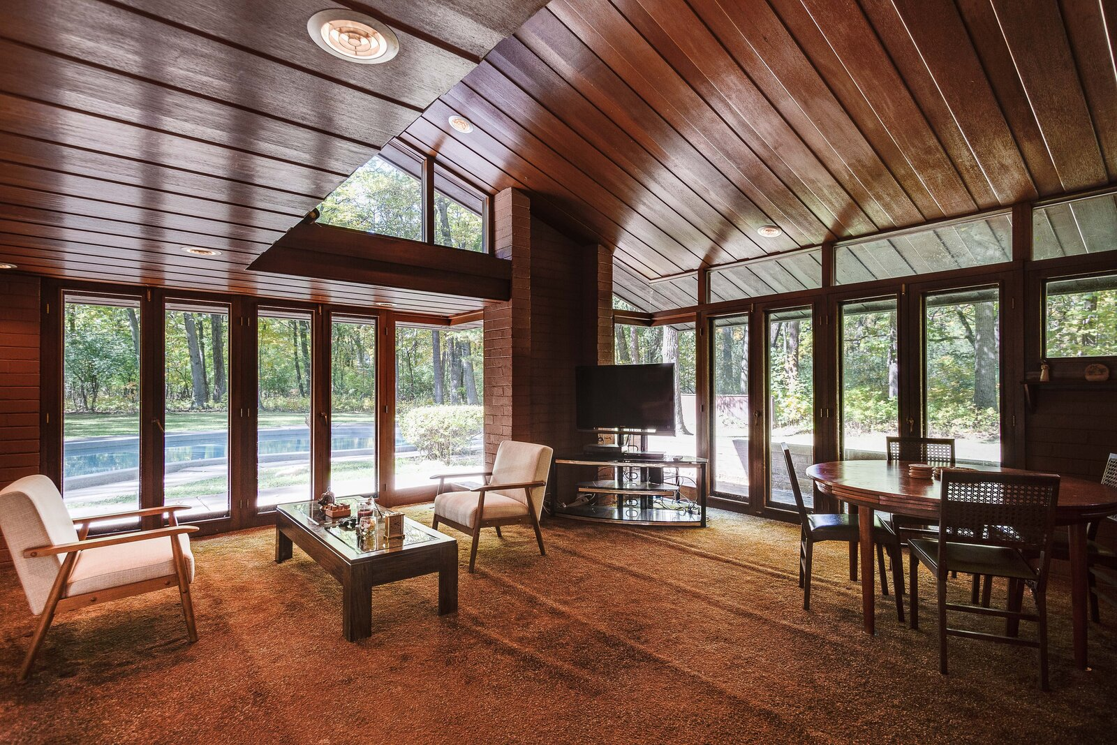 The family room was also part of the additional 2,000 square feet added to the home.  Photo 10 of 17 in For the First Time Ever, This Winsome Illinois Home by Frank Lloyd Wright Is on the Market