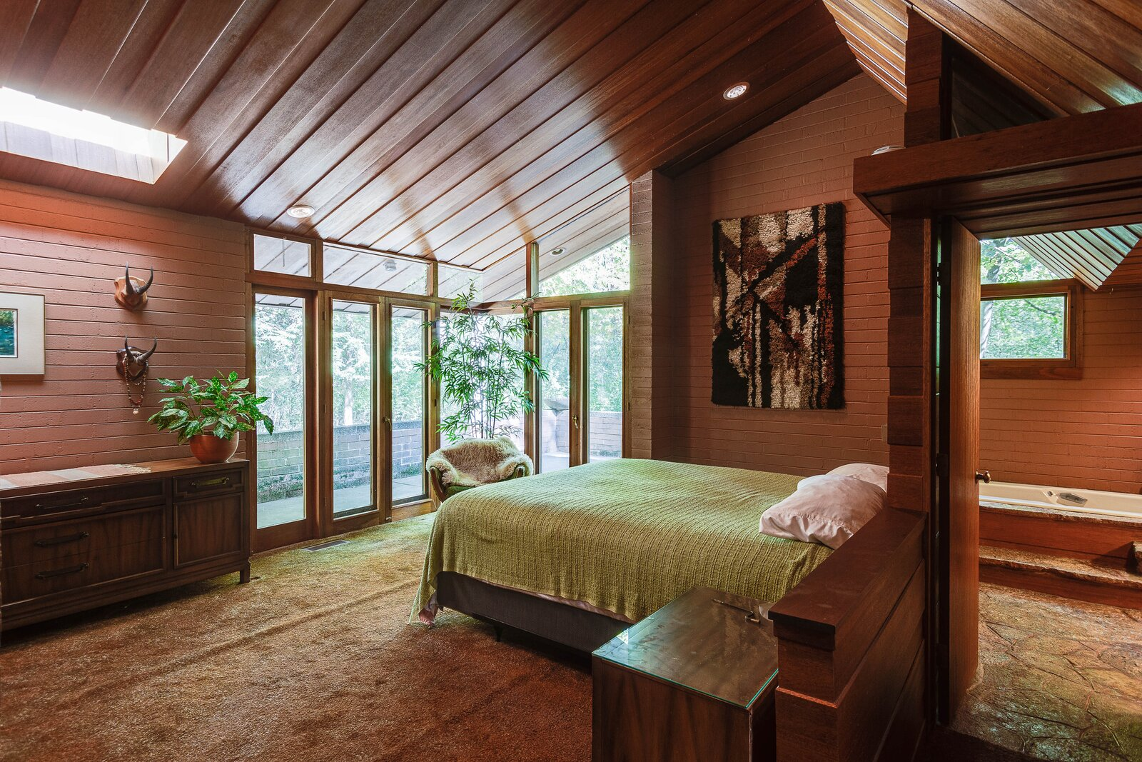 At the opposite end of the home, the principal suite provides access to a private terrace.  Photo 11 of 17 in For the First Time Ever, This Winsome Illinois Home by Frank Lloyd Wright Is on the Market