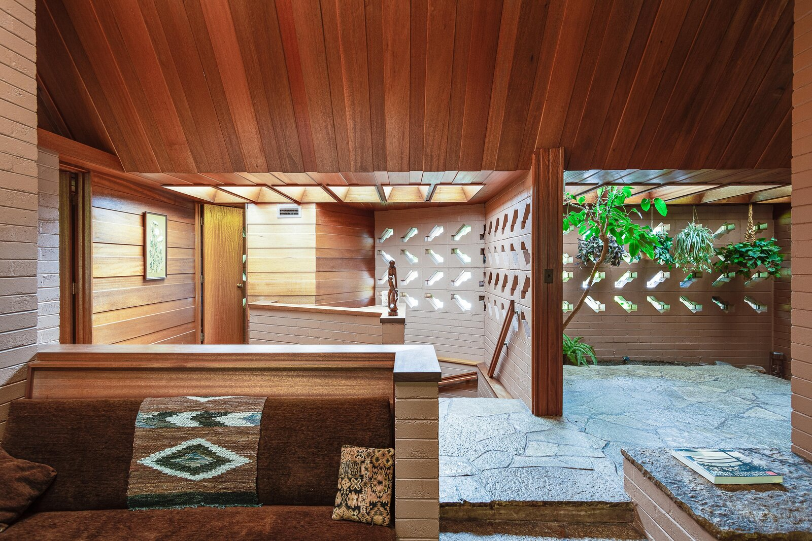 The sunken sitting area, along with the principal bedroom and walkway to the left of the entryway were all reportedly added as part of the 1980s expansion.  Photo 4 of 17 in For the First Time Ever, This Winsome Illinois Home by Frank Lloyd Wright Is on the Market