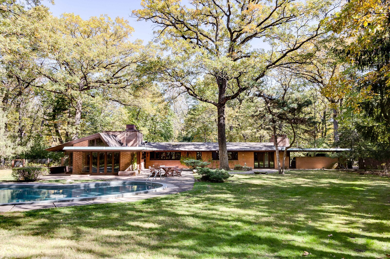 Available for the first time in decades, the 1950 John O. Carr house by Frank Lloyd Wright sits on an idyllic three-acre lot about 25 miles northwest of Chicago. Wright's original design details heavily informed expansions to the home completed in the 1980s.  Photo 1 of 17 in For the First Time Ever, This Winsome Illinois Home by Frank Lloyd Wright Is on the Market