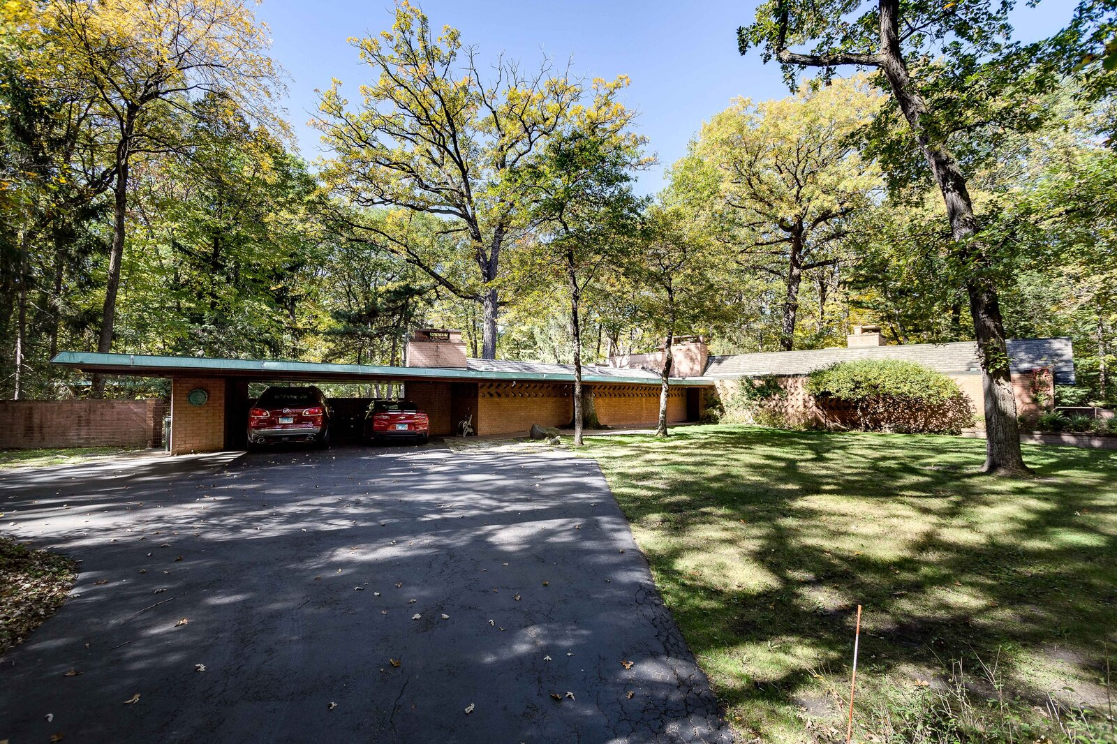 A carport is located at the end of another wing.  Photo 15 of 17 in For the First Time Ever, This Winsome Illinois Home by Frank Lloyd Wright Is on the Market
