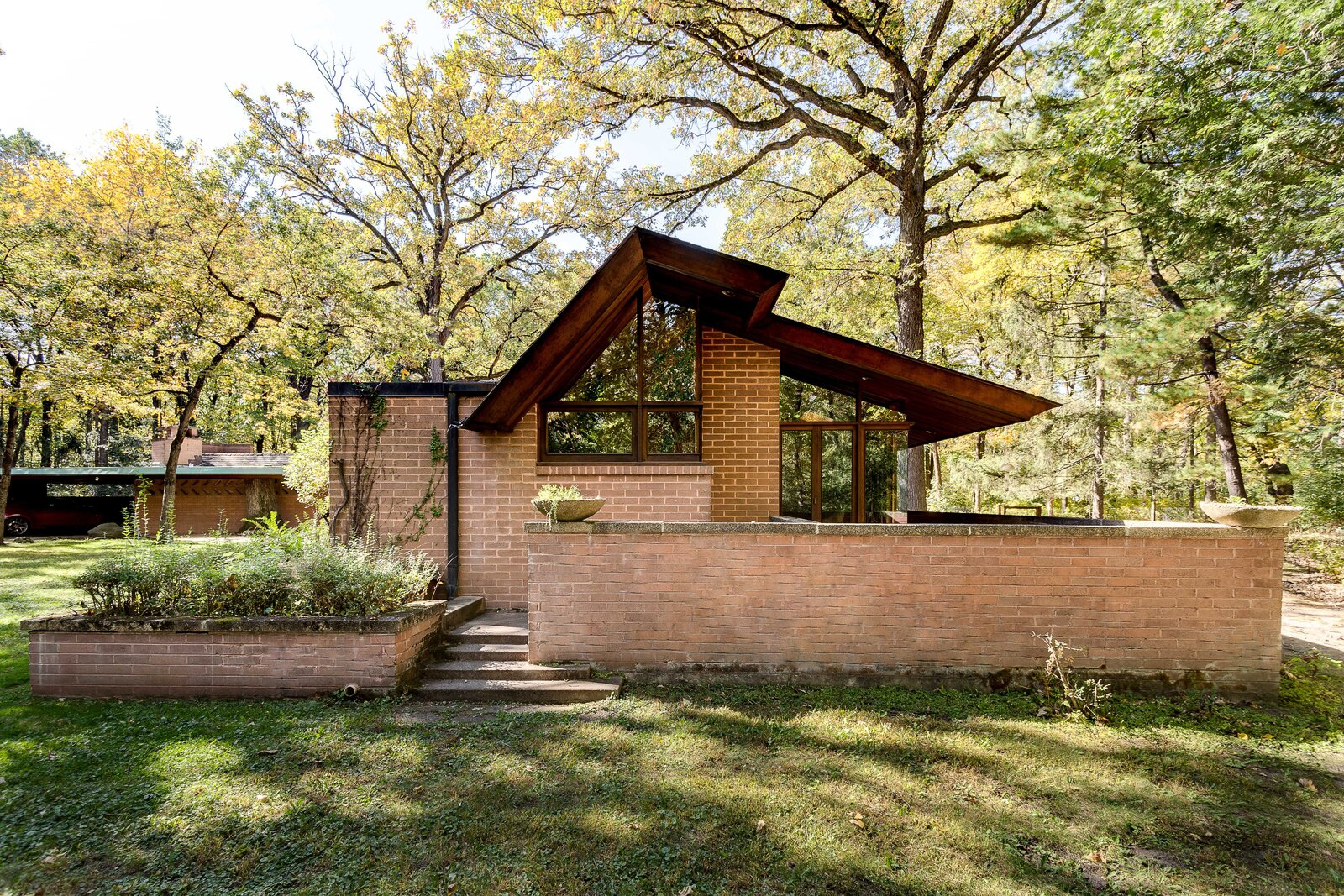 The principal bedroom also provides direct access to a private terrace.  Photo 14 of 17 in For the First Time Ever, This Winsome Illinois Home by Frank Lloyd Wright Is on the Market