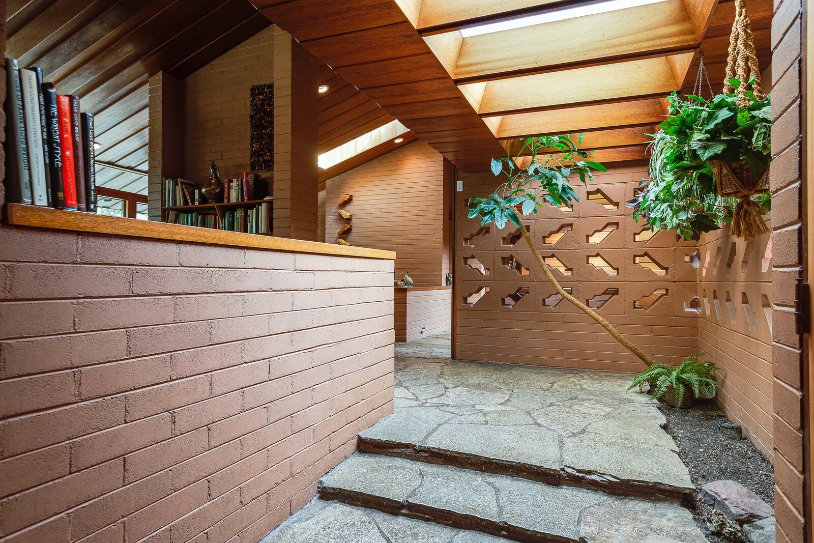 Original sections of the home blend with those added by the now-dissolved firm of Busche & Markson. Here, the original entryway features a unique version of Wright's pierced block designs allows sunlight from multiple skylights and the exterior to penetrate adjacent rooms.  Photo 2 of 17 in For the First Time Ever, This Winsome Illinois Home by Frank Lloyd Wright Is on the Market