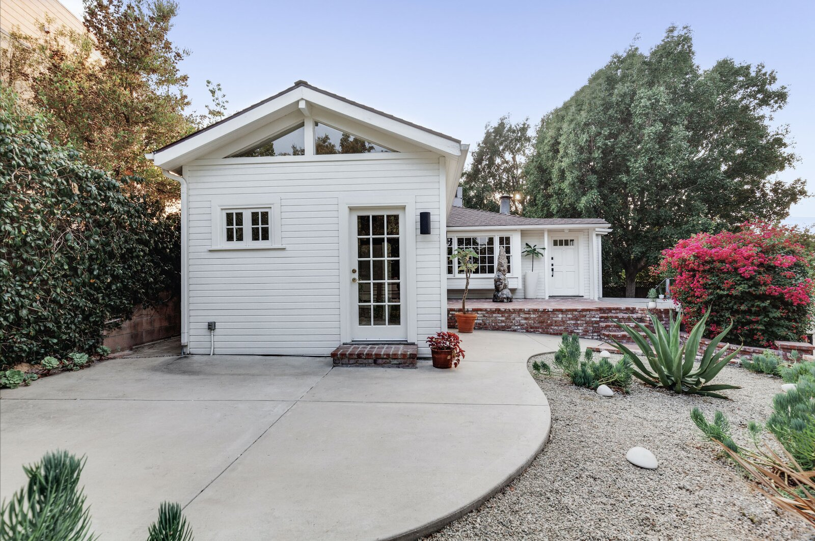 The front of the home features a new concrete patio that extends from the home office and dining area.  Photo 12 of 16 in Listed at $950K, This Clean-Lined Cottage in Los Angeles Is a Fresh Take on City Living
