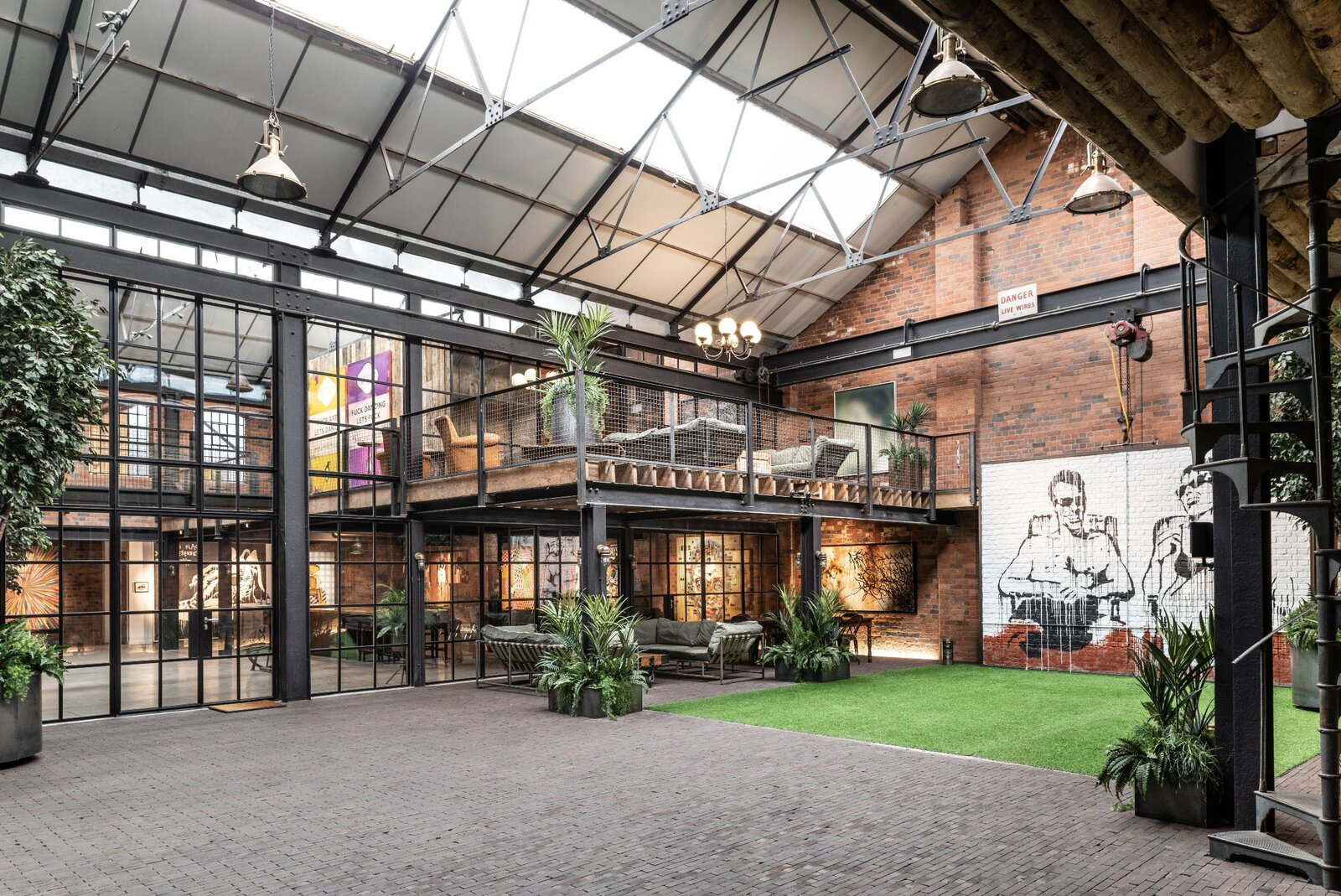 """The vast volume is topped by a gabled roof, complete with massive skylights for natural light. In addition to offering income opportunities as a rental venue, the courtyard provides off-street parking and space for indoor recreation.  Photo 15 of 15 in This Live/Work Warehouse That Starred in Steven Spielberg's """"Ready Player One"""" Lists for £2.75M"""