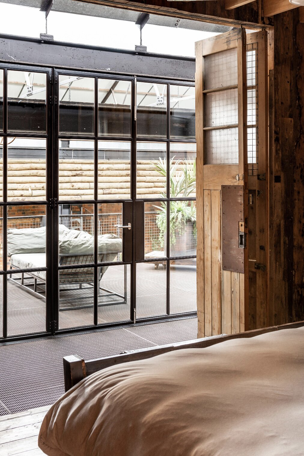 """A bedroom looks out onto the mezzanine.  Photo 6 of 15 in This Live/Work Warehouse That Starred in Steven Spielberg's """"Ready Player One"""" Lists for £2.75M"""
