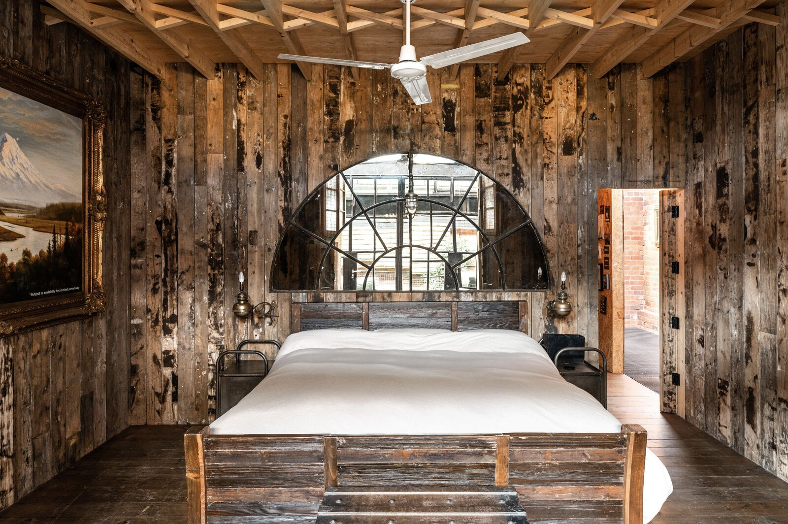 """The bedroom walls are clad in reclaimed timber.  Photo 7 of 15 in This Live/Work Warehouse That Starred in Steven Spielberg's """"Ready Player One"""" Lists for £2.75M"""