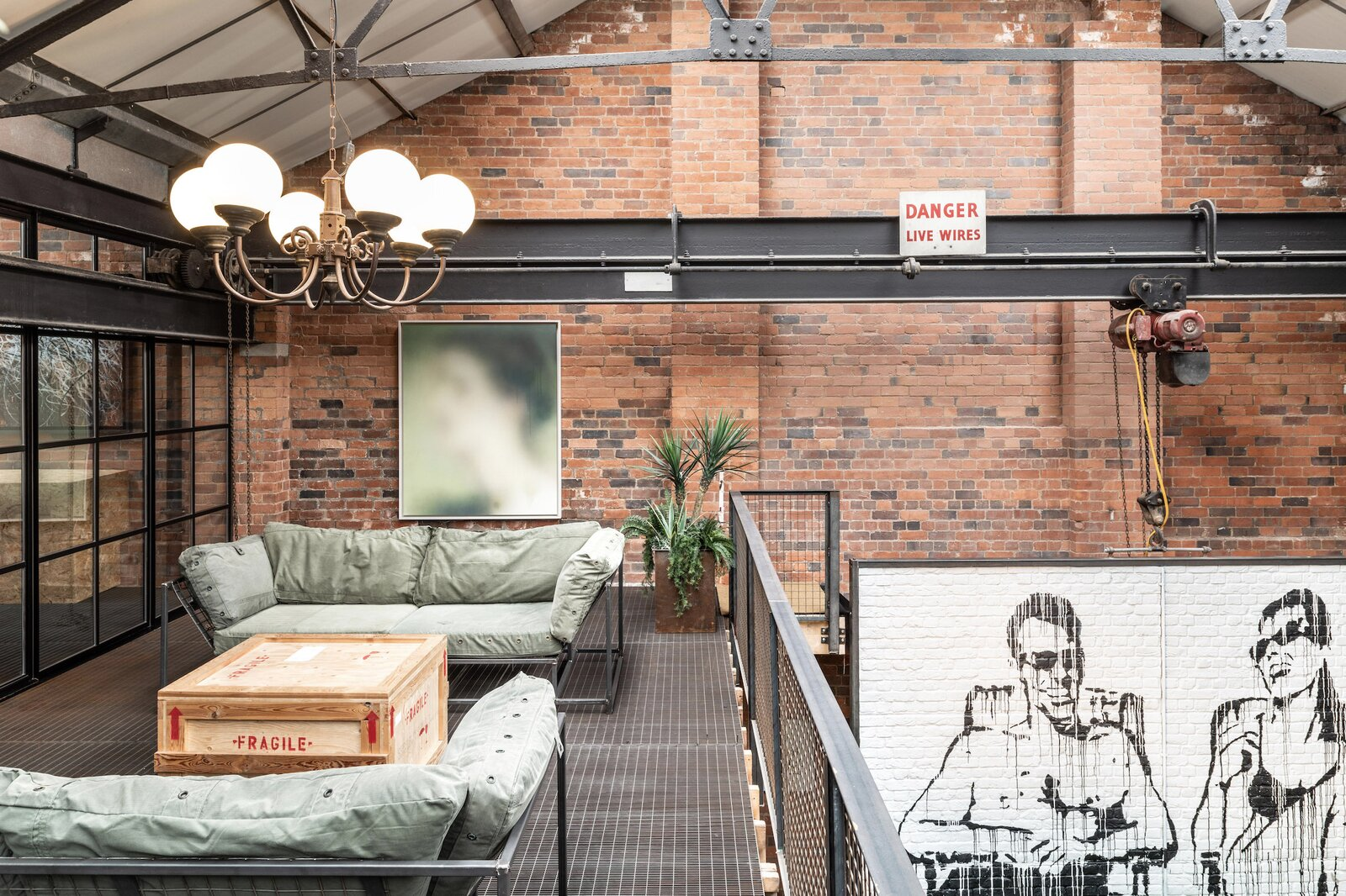 "Motorized conveyors and other remnants of the building's industrial past were retained to incorporate the living spaces while making minimal changes to the existing structure.  Photo 5 of 15 in This Live/Work Warehouse That Starred in Steven Spielberg's ""Ready Player One"" Lists for £2.75M"