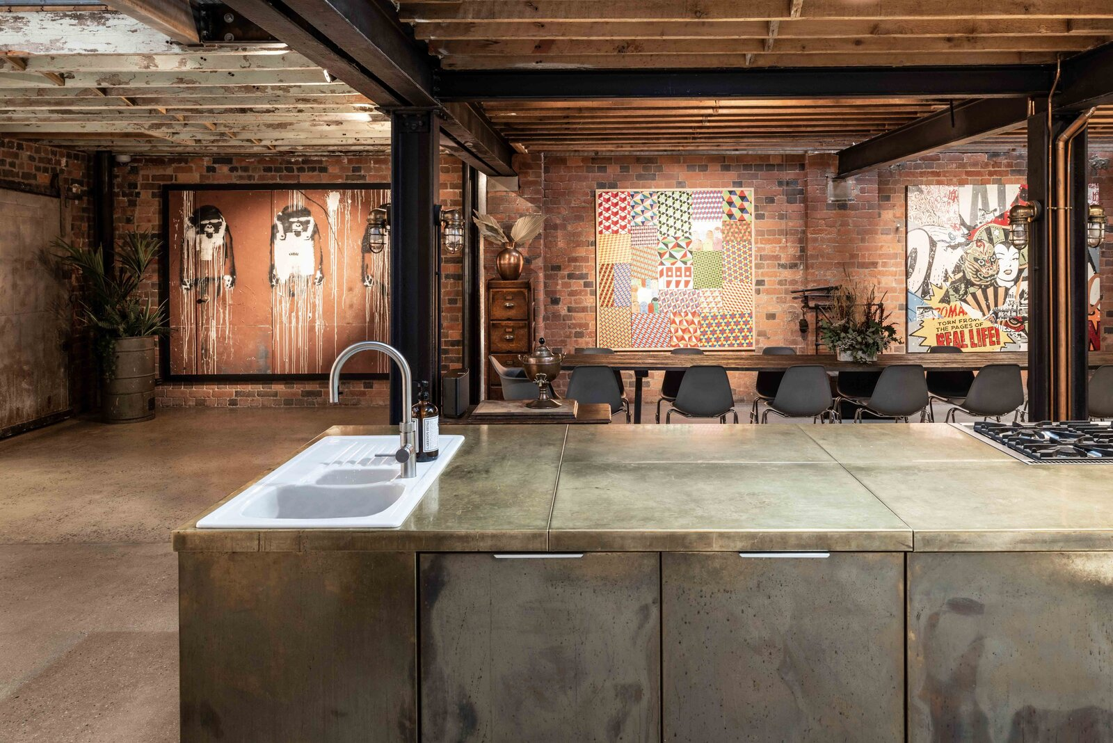 """The long kitchen island was custom made and inspired by the design of a welder's bench.  Photo 3 of 15 in This Live/Work Warehouse That Starred in Steven Spielberg's """"Ready Player One"""" Lists for £2.75M"""