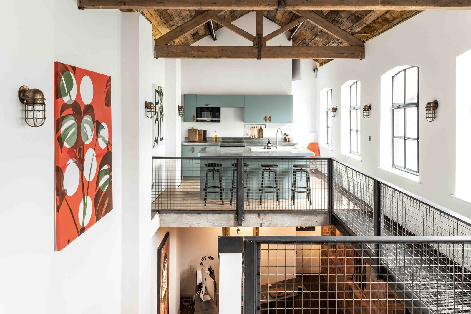 """A full kitchen is located on the opposite side of the residence, while another workspace is located down below.  Photo 11 of 15 in This Live/Work Warehouse That Starred in Steven Spielberg's """"Ready Player One"""" Lists for £2.75M"""