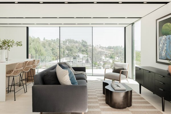With generous floor-to-ceiling windows, the interiors get plenty of all-day light. As a designer of lifestyle hotel interiors, Oni is an expert at balancing comfort with function, as reflected in the living and dining areas.