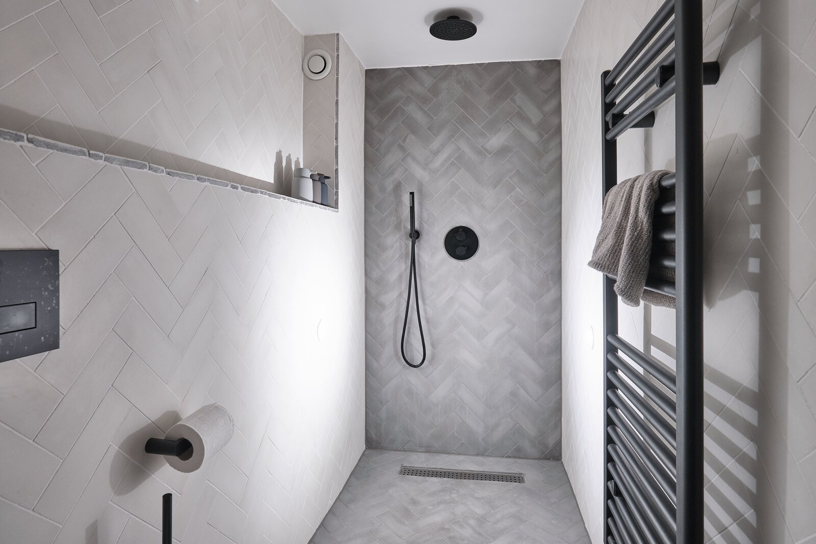 """Bath Room and Full Shower The en suite shower room offers tile by <span style=""""font-family: Theinhardt, -apple-system, BlinkMacSystemFont, &quot;Segoe UI&quot;, Roboto, Oxygen-Sans, Ubuntu, Cantarell, &quot;Helvetica Neue&quot;, sans-serif;"""">Bert &amp; May alongside Vola fixtures.</span>  Photo 10 of 13 in For £1.2M, Snag This Spacious London Flat Inside a Converted Victorian Schoolhouse"""