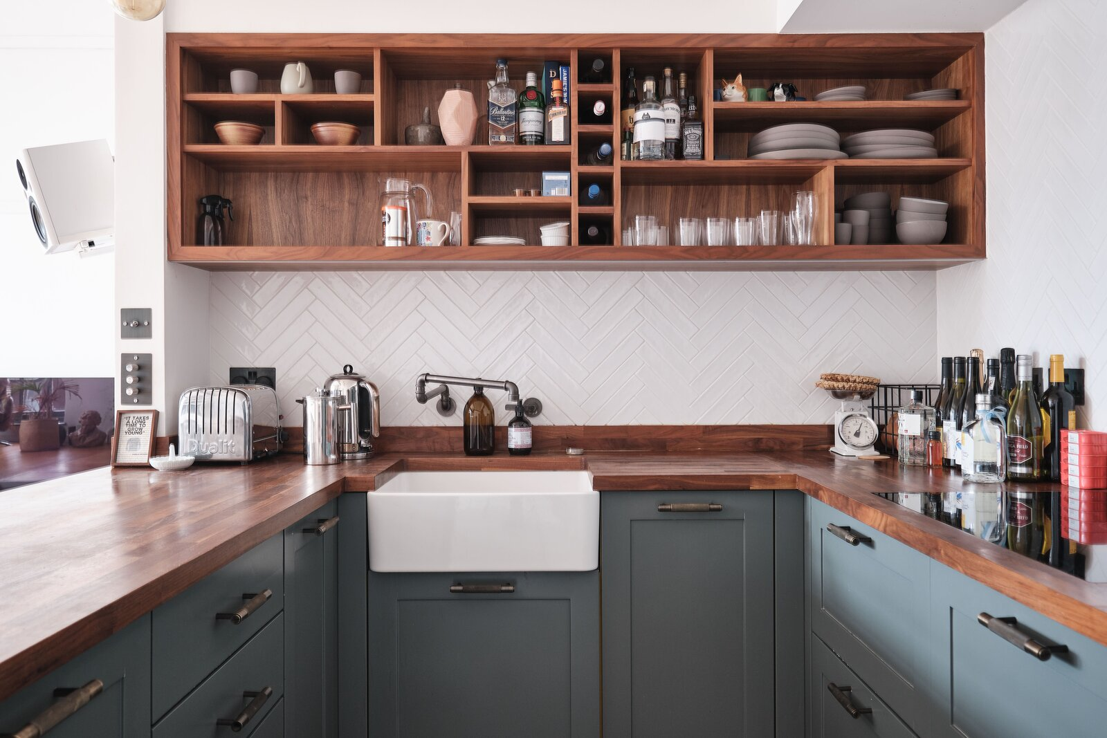 Kitchen, Colorful Cabinet, Wood Counter, Open Cabinet, and Wood Cabinet Colored lower cabinetry contrast with custom-made open shelving and butcher block counters.  Photo 8 of 13 in For £1.2M, Snag This Spacious London Flat Inside a Converted Victorian Schoolhouse