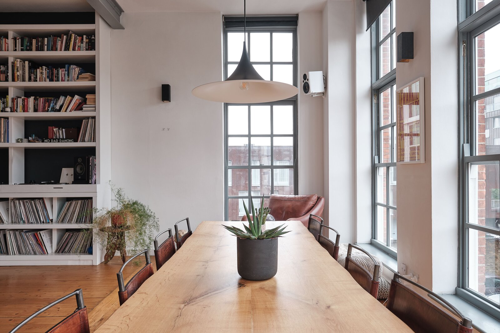 Dining Room, Chair, Medium Hardwood Floor, Table, and Pendant Lighting Another view of the dining area overlooking the building's inner courtyard.  Photo 6 of 13 in For £1.2M, Snag This Spacious London Flat Inside a Converted Victorian Schoolhouse