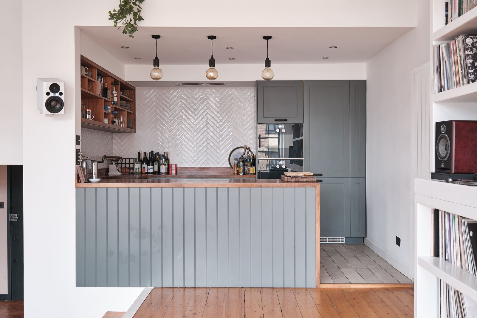 """Kitchen, Wood Counter, and Colorful Cabinet The updated kitchen comes with a a pair of <span style=""""font-family: Theinhardt, -apple-system, BlinkMacSystemFont, &quot;Segoe UI&quot;, Roboto, Oxygen-Sans, Ubuntu, Cantarell, &quot;Helvetica Neue&quot;, sans-serif;"""">Gaggenau ovens and Miele appliances</span><span style=""""font-family: Theinhardt, -apple-system, BlinkMacSystemFont, &quot;Segoe UI&quot;, Roboto, Oxygen-Sans, Ubuntu, Cantarell, &quot;Helvetica Neue&quot;, sans-serif;"""">. </span>  Photo 7 of 13 in For £1.2M, Snag This Spacious London Flat Inside a Converted Victorian Schoolhouse"""