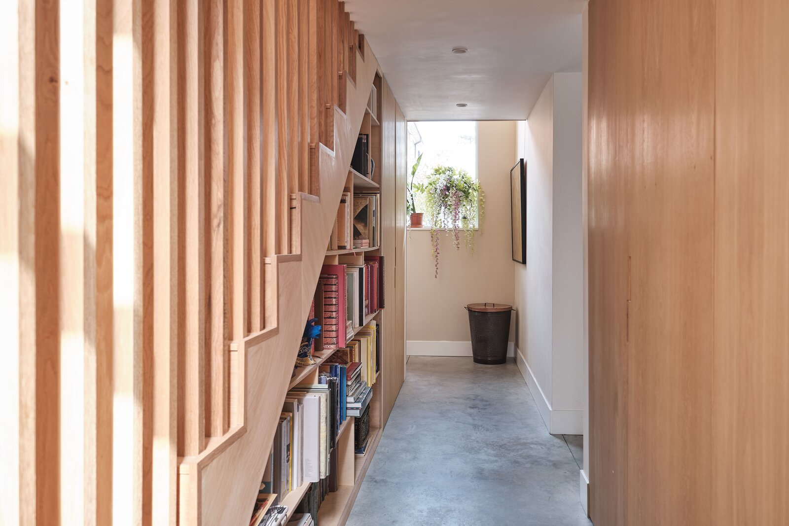 Bespoke shelving and storage line a hallway behind the kitchen that leads to the bedrooms.  Photo 10 of 14 in This Former Chapel, Now a Heavenly Artist's Studio and Home, Lists for £1.6M