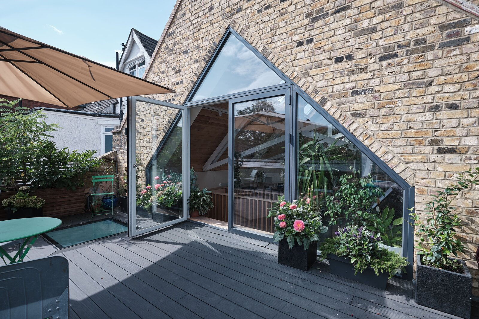 Double glass doors open onto the terrace, which  Photo 9 of 14 in This Former Chapel, Now a Heavenly Artist's Studio and Home, Lists for £1.6M