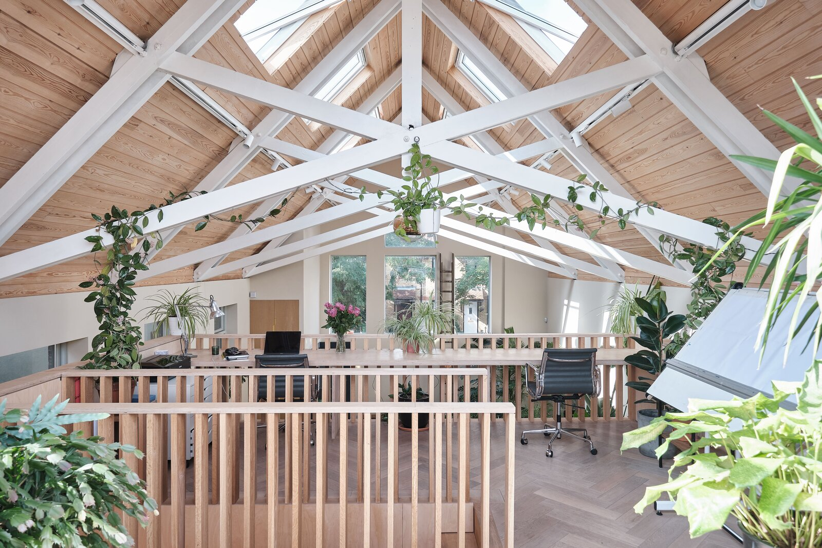 The mezzanine level is a dreamy workspace—offering a 12-foot-long desk overlooking the living area, as well as direct access to the rooftop terrace and an abundance of natural light.  Photo 7 of 14 in This Former Chapel, Now a Heavenly Artist's Studio and Home, Lists for £1.6M