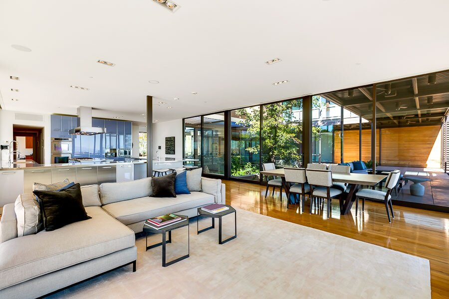 """A seating area and informal dining space open to one of many covered outdoor spaces.  Photo 7 of 12 in Asking $10.5M, This Desert Prefab by Marmol Radziner Doesn't Want for """"Wow"""" Factor"""