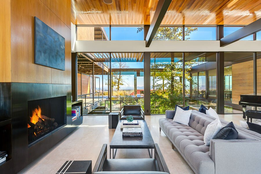 """At the center of the home, a nearly double-height living area overlooks a below-grade central courtyard that is enclosed by the structure on all sides.  Photo 3 of 12 in Asking $10.5M, This Desert Prefab by Marmol Radziner Doesn't Want for """"Wow"""" Factor"""