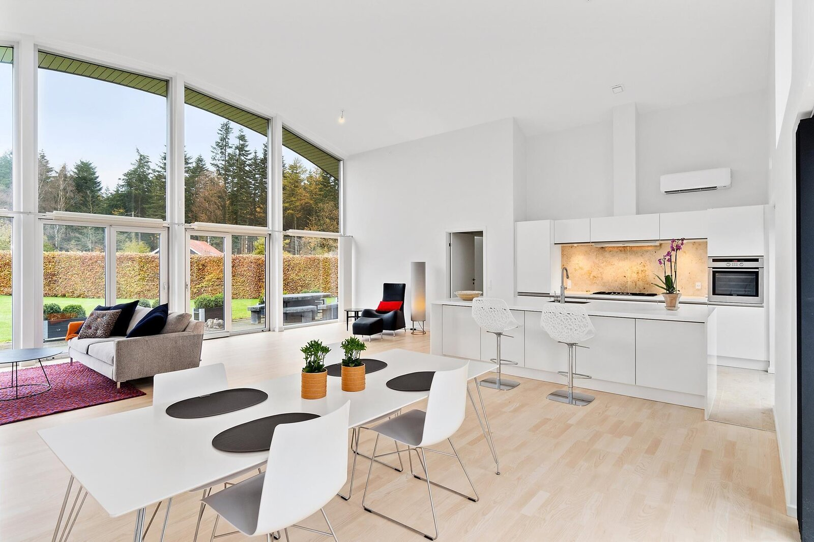 The open-concept room offers enough space for seating and dining areas, as well as a recently renovated kitchen in one corner.  Photo 3 of 10 in Bjarke Ingels's Hobbit-Esque Hill House Lists for $715K