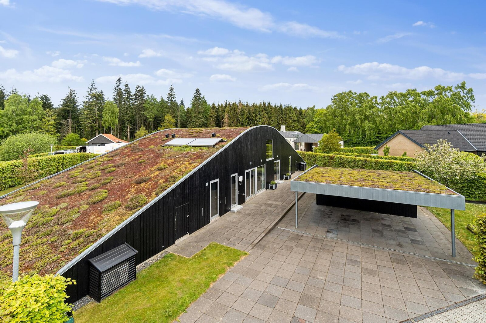 Another view of the carport and rear facade.  Photo 10 of 10 in Bjarke Ingels's Hobbit-Esque Hill House Lists for $715K