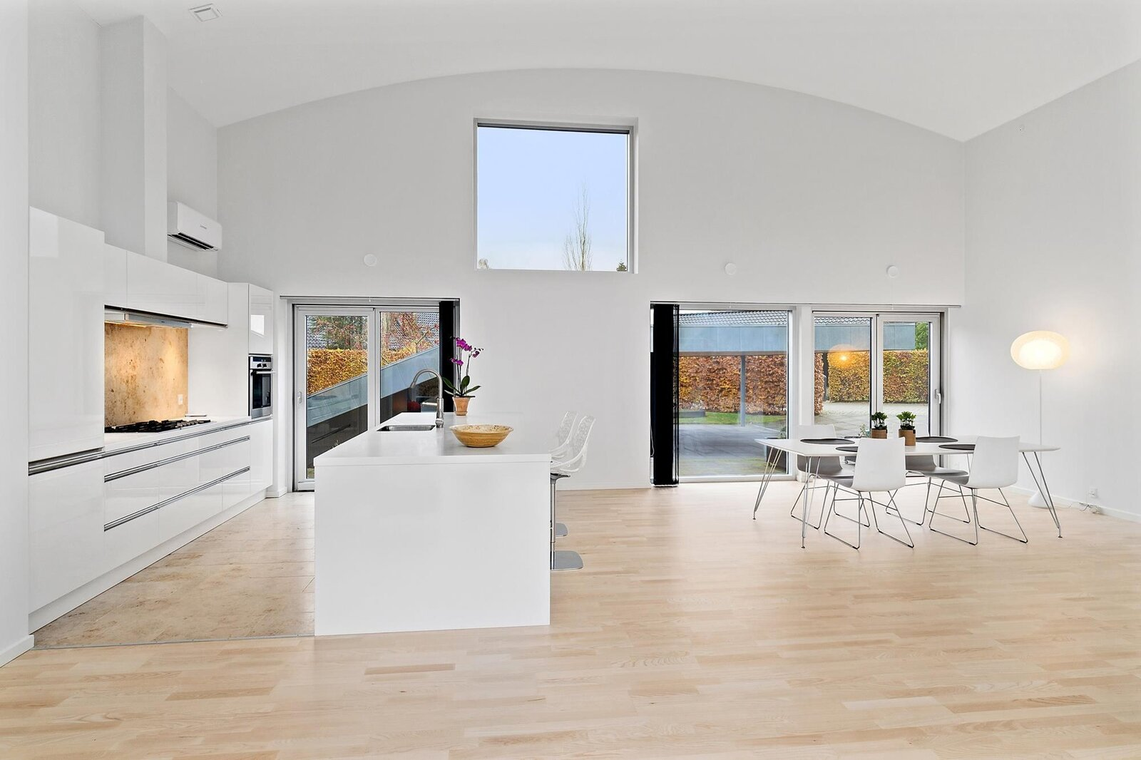 Sliding glass doors in the kitchen and dining area lead to the rear patio and driveway.  Photo 5 of 10 in Bjarke Ingels's Hobbit-Esque Hill House Lists for $715K