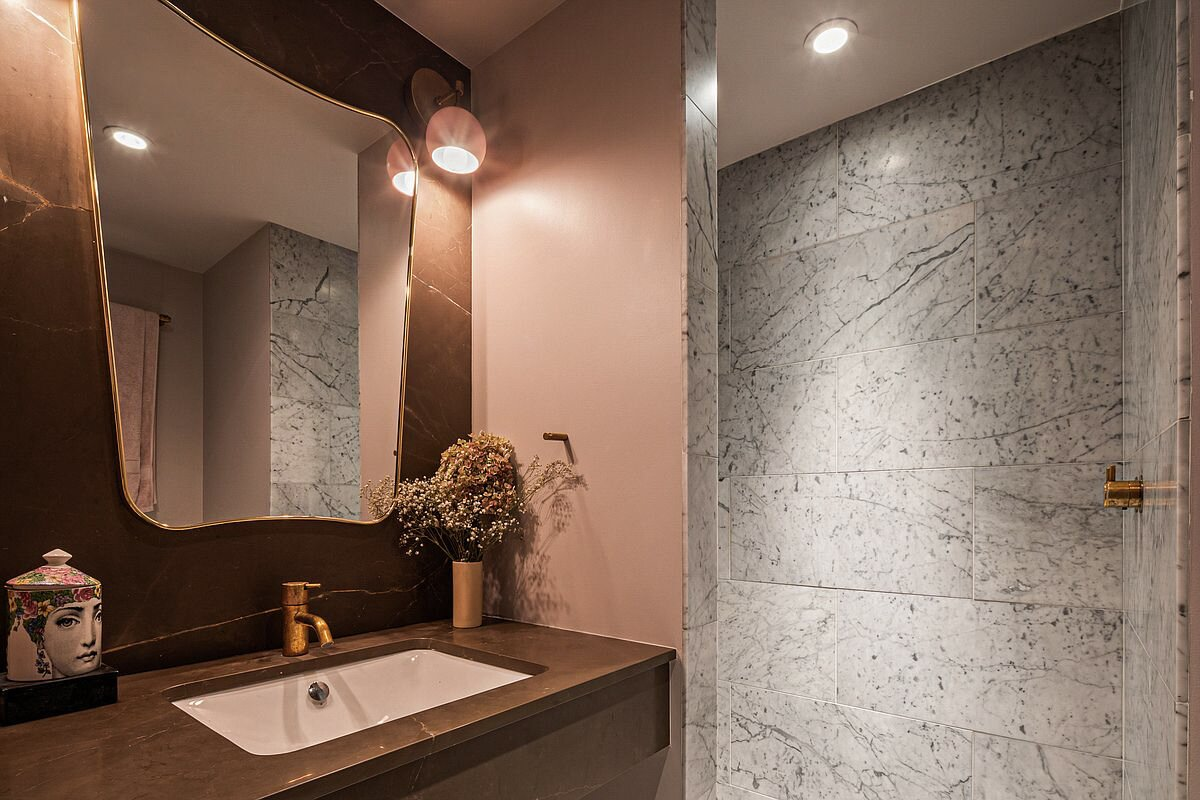 The second bathroom features more marble-clad walls and designer finishes.  Photo 9 of 10 in Supermodel Elsa Hosk Lists Her Chic SoHo Loft for $3.5M