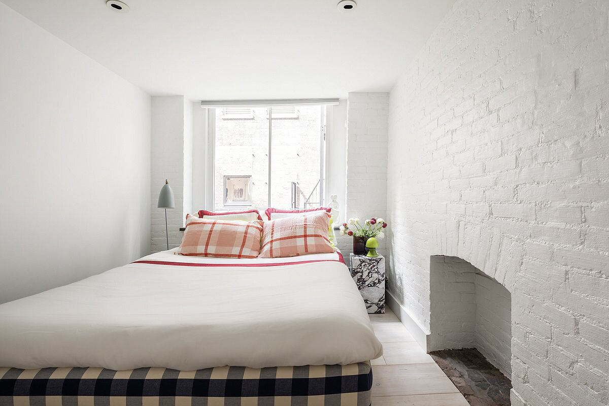 A look at the main-level bedroom, which features the remnants of an old fireplace.  Photo 8 of 10 in Supermodel Elsa Hosk Lists Her Chic SoHo Loft for $3.5M