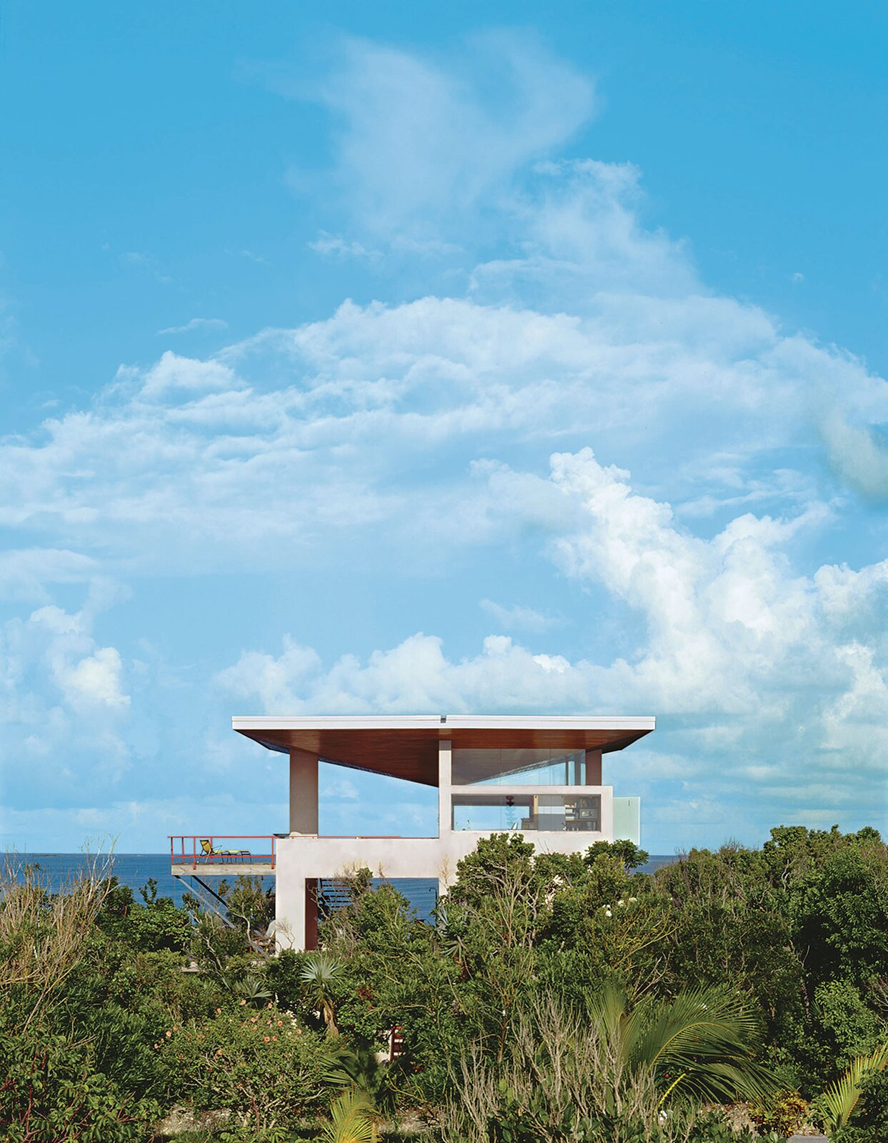 The Taylor Vacation House looks out on the Sea of Abaco in the Bahamas. It's sheltered from the intense summer sun by an umbrella roof that also collects rainwater for all domestic needs.  Photo 6 of 6 in Let's Be Frank