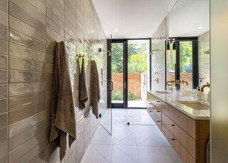 An outdoor shower extends off the main bathroom.