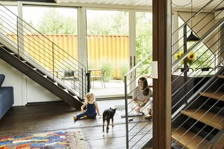 Victoria and her daughter, Bowie, along with the family dog, in the open kitchen/dining area.