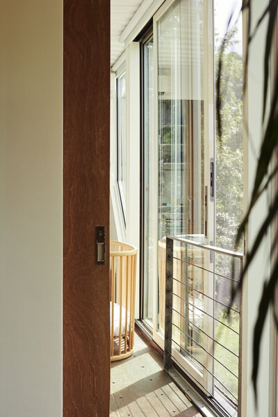 A sliding glass door provides fresh air in one of three bedrooms.