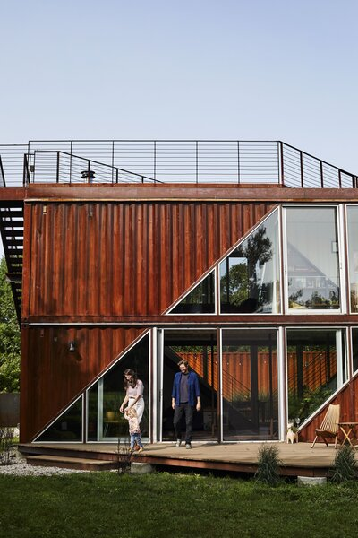 Turning a shipping container into a home is rarely as simple as it sounds, but design studio LOT-EK set out to prove that these vessels could become the raw material for an efficient prefab construction process with a house in upstate New York. Victoria Masters, Dave Sutton, and their daughter, Bowie, live in the six merged containers.